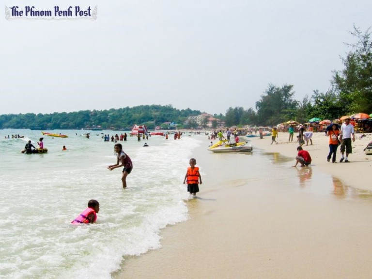 People relax at a beach in Sihanoukville in 2013. The National Committee for Cambodia Bay Management and Development issued a statement earlier this week calling for developers to abide by a 50-metre construction-free zone from the shoreline
