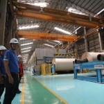 Thai Cane Paper's plant at Kanchanaburi where Konecranes cranes are used in the production of more than 100,000 tons of product a year. Mr Somkieat Dumthong from the plant's Mechanical Maintenance section (foreground) stresses the importance of safety when loading cranes.