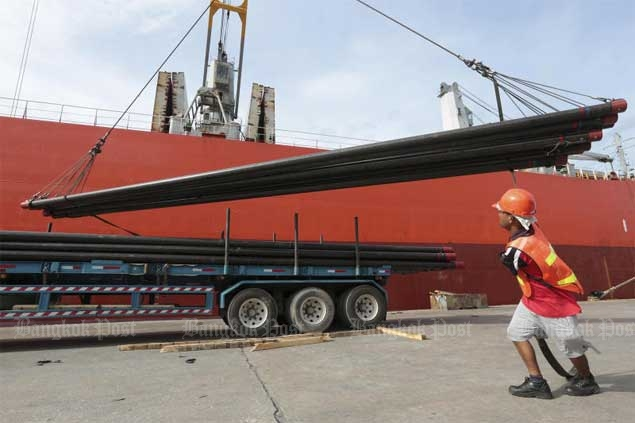 A worker unloads steel products imported from China. To avoid competition with cheap Chinese steel, The Steel Plc is branching into the power-generating sector.