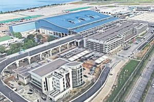 A bird's-eye view of the new passenger terminal (with blue roof), a key part of Phuket airport's long-delayed expansion.