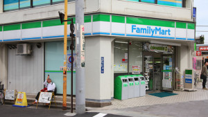 TOKYO - APRIL 19: Family Mart convenience store on April 19 2012 in Tokyo Japan. FamilyMart is one of largest convenience store franchise chains in Japan with 7604 shops (2012).