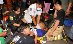 Rescue workers treat a victim after the accident, possibly caused by a fire retardant chemical at the headquarters of Thailand's Siam Commercial Bank in Bangkok.