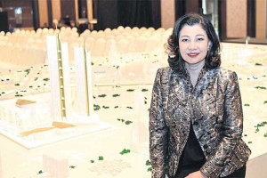 Chadatip Chutrakul, director of Iconsiam Co, poses with a model of the multi-use project scheduled to open next year.