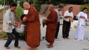 Monks at Nakhon Ratchasima mark Magha Puja festivalImage copyright Matthew Richards/Pacific Press/LightRocket/Getty