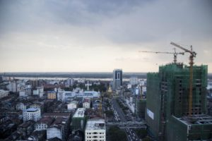 Construction cranes loom large above a high-rise development on the corner of Sule Pagoda and Anawratha Roads in downtown Yangon.