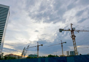 Construction site cranes stand against early morning clouds in Yangon on June 23. Photo: EPAConstruction site cranes stand against early morning clouds in Yangon on June 23.