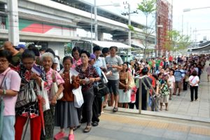 People line up to register for free test run tickets for the Purple Line on June 5 at MRT Khlong Bang Phai in Bangkok.