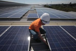 A technician checks out a solar array installed in Samut Prakan. Up to 19 solar farm licences have been revoked after operators failed to start commercial operations as scheduled. Some licence holders had done nothing to begin preparing their solar farms in the run-up to a June deadline.