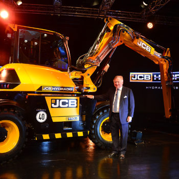 JCB Chairman Lord Bamford pictured with the newly-launched JCB Hydradig