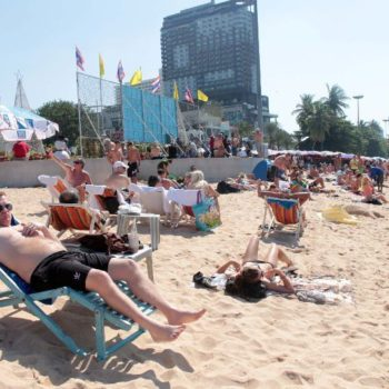 Foreign tourists relax on Pattaya Beach